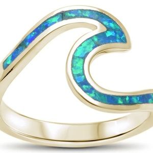 Gold and .925 sterling silver blue opal wave ring